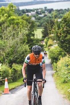 Chris Johnson climbing up a 25 percent gradient hill at the end of a 103-mile training ride from Brockwood, Surrey to Studland, Dorset. Photo by Dan Monaghan