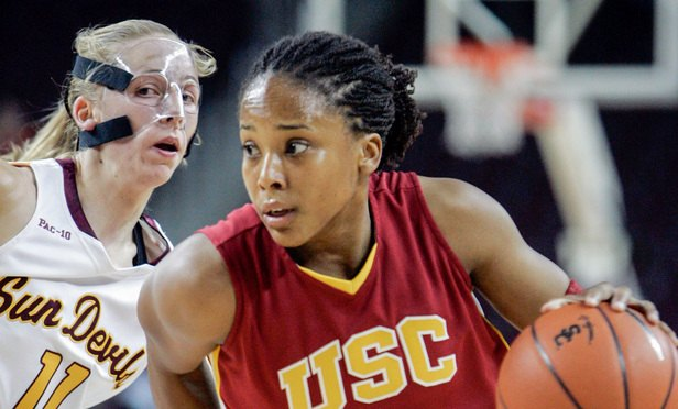 Southern California forward Camille LeNoir (1) drives past Arizona State guard Kate Engelbrecht (11) in the first half of an NCAA college basketball game in the Pac-10 women's tournament in Los Angeles Friday, March 13, 2009. (AP Photo/Reed Saxon)