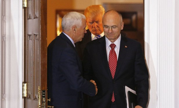 Vice President-elect Mike Pence shakes hands with Andrew Puzder, chief executive of CKE Restaurants, after meeting with President-elect Donald Trump (C), while leaving the clubhouse of Trump International Golf Club, November 19, 2016 in Bedminster Township, New Jersey. (Photo: Aude Guerrucci/AP)