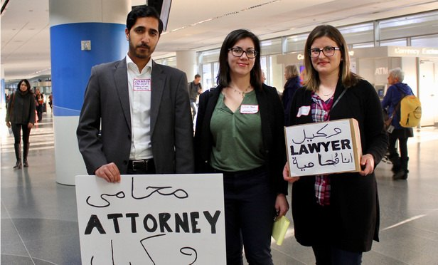 Left to right, immigration lawyer Junaid Sulahry stands in the international arrivals hall of San Francisco International Airport with fellow attorney volunteers Julie Hiatt and Marianna, who declined to give her last name. (Photo: Ben Hancock/ALM)