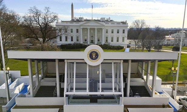 The inaugural parade presidential reviewing stand on Pennsylvania Avenue in front of the White House, Sunday, Jan. 15, 2017, is nearly completed in preparation for the 58th presidential inauguration, on Friday, Jan. 20. (AP Photo/Pablo Martinez Monsivais)