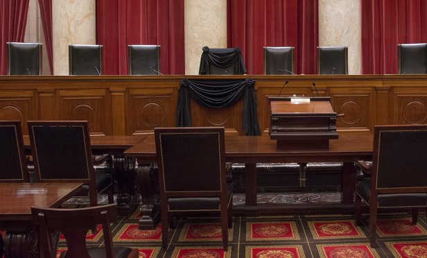 The Courtroom of the Supreme Court showing Associate Justice Antonin Scalia's Bench Chair and the Bench in front of his seat draped in black following his death on February 13, 2016. Credit: Franz Jantzen/Collection of the Supreme Court of the United States.