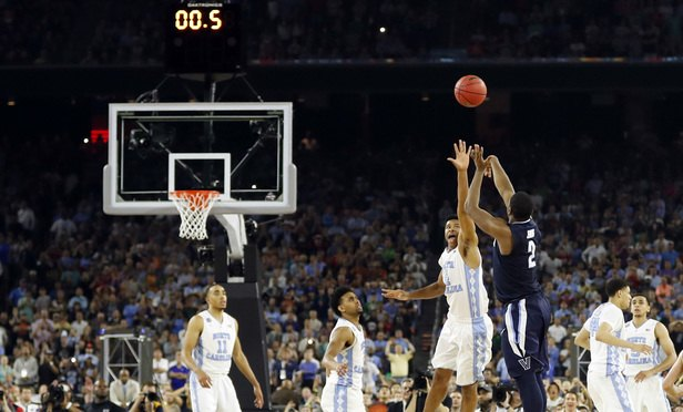 Villanova's Kris Jenkins makes the game-winning three-point shot during the second half of the NCAA Final Four tournament college basketball championship game against North Carolina, in Houston. North Carolina players are, from left: Brice Johnson (11), Joel Berry, Isiah Hicks (4), Justin Jackson (44) and Marcus Paige (5). Nearly a year after Jenkins' shot, the Wildcats and Tar Heels are both No. 1 seeds in the NCAA Tournament. (AP Photo/David J. Phillip, File)