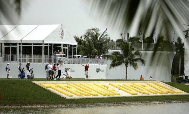 Players tee off from the ninth hole during the first round of the Cadillac Championship golf tournament at Trump National Doral. (Photo: Lynne Sladky/AP)