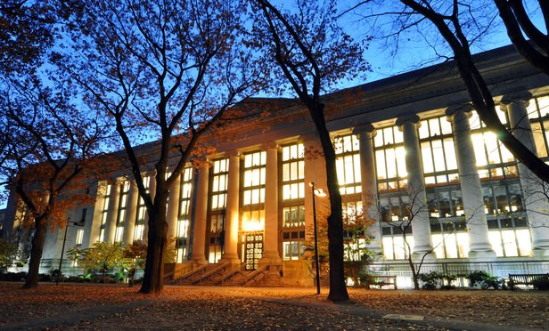 Harvard Law School Library in Langdell Hall at night. (Photo: Chensiyuan via Wikimedia Commons)