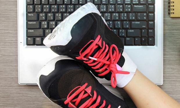 Sneakers on keyboard. Shutterstock.