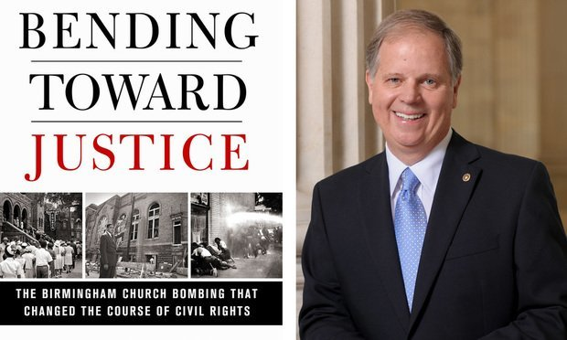 "Sen. Doug Jones, right, and his new book, ""Bending Toward Justice."""