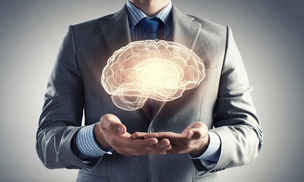 Businessman holding digital image of brain.
