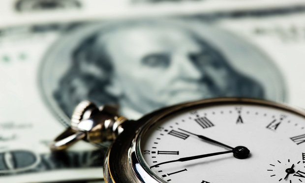Stock image of money and stopwatch