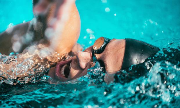 Swimming woman. Photo: Shutterstock.