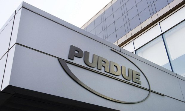 This Tuesday, May 8, 2007, file photo shows the Purdue Pharma logo at its offices in Stamford, Conn. The company is facing some 2,000 lawsuits in the United States over its role in unleashing an addiction crisis that has claimed 400,000 lives.