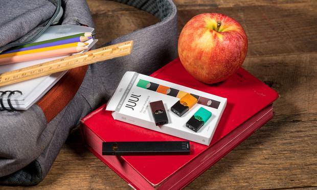 Juul device near a school backpack