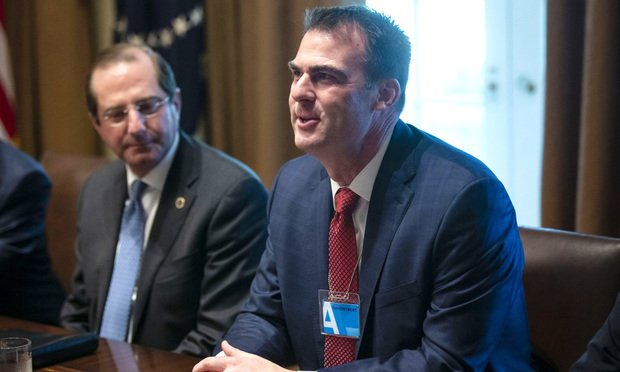 Governor-elect Kevin Stitt (R, OK), speaks beside Alex Azar, secretary of Health and Human Services (HHS), during a meeting with Governors-Elect, in the Cabinet Room, on Thursday, Dec. 13, 2018 at the White House in Washington, D.C. Photographer: Al Drago/Bloomberg