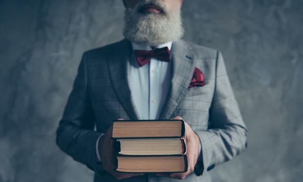 Older professor with books.