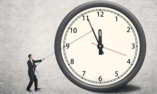 Man beside big clock.