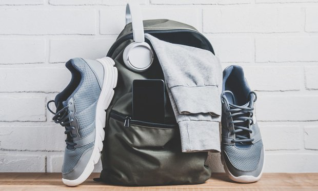 Green backpack with sportswear and sneakers  The concept of fitness or running Article 202001161614.'