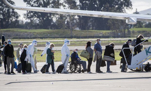 Passengers who were on the Carnival Corp. Grand Princess cruise ship board a chartered plane at the Oakland International Airport in Oakland, California, U.S., on Wednesday, March 11, 2020. The cruise ship that spent days circling the waters off San Francisco with people sickened by the new coronavirus returned to land Monday at an isolated dock, to begin the long process of offloading passengers into quarantine. Photographer: David Paul Morris/Bloomberg