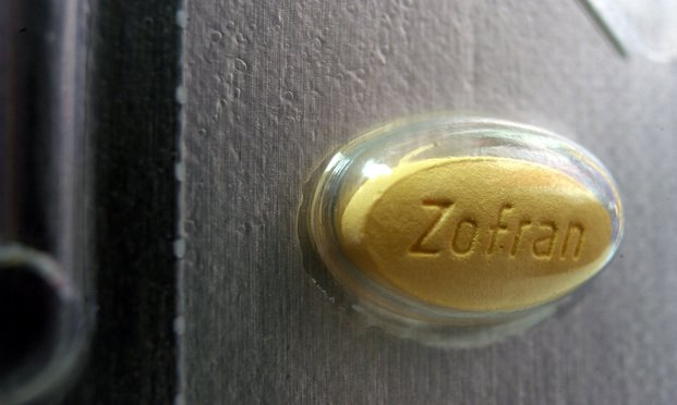 A Zofran pill, manufactured by GlaxoSmithKline Plc, is pictured in its packaging at a Walgreen's pharmacy in the Brooklyn borough of New York on Tuesday, September 23, 2003. Zofran is an anti-nausea medication for cancer patients undergoing chemotherapy. Drug makers are betting that the market for treating cancer side effects has room to expand. Photographer: Michael Nagle/Bloomberg News