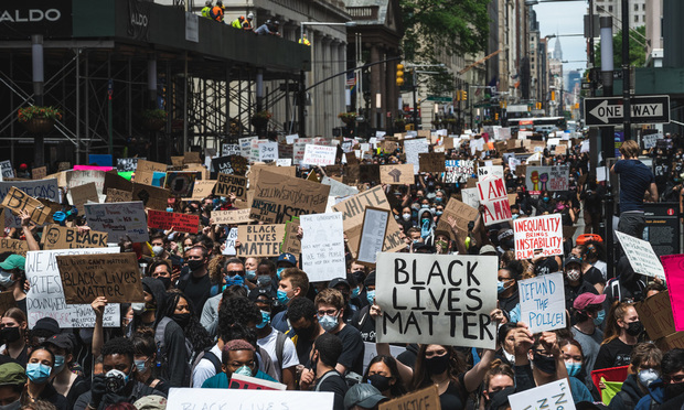 Black Lives Matter protesters march through downtown Manhattan