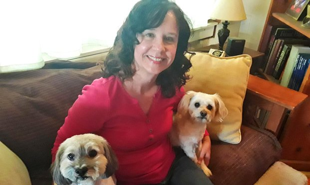 Cheryl Bigos of Community Legal Aid So Cal poses with pets Captain (left) and Molly. Courtesy Photo.