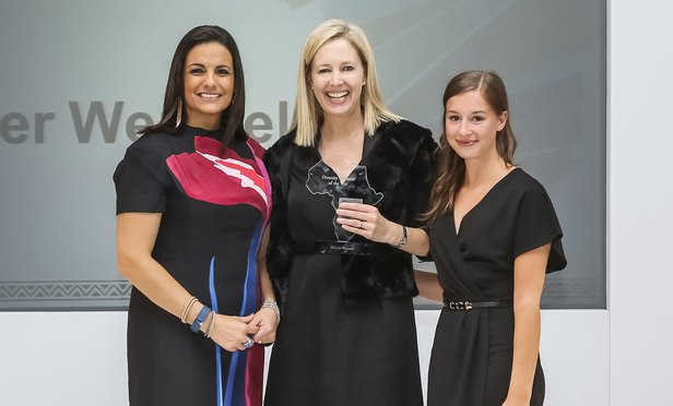 Managing partner Sally Hutton collects the award from awards host broadcaster Leanne Manas (left) and Isobel Rees, Legal Week Events