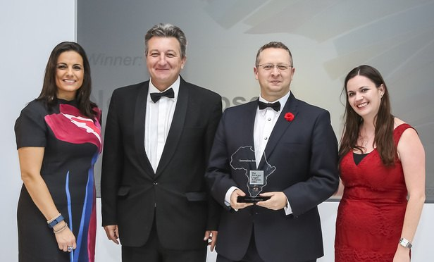 Chief business development and marketing officer for Africa Nico Olwagen (with award) and Greg Nott, director, awards host broadcaster Leanne Manas (left) and Legal Week's Natalie Hill (right)