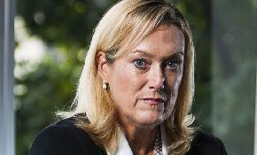 Partner in sex bias case says Norton Rose pushed Chadbourne to fire her before merger