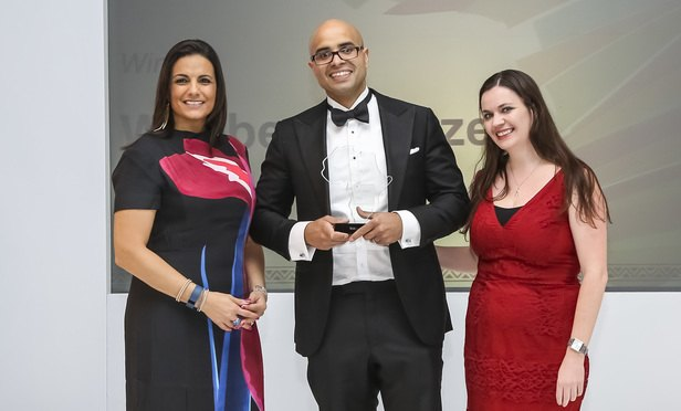 Corporate partner Jesse Watson receives the award from awards host, broadcaster Leanne Manas (left) and Natalie Hill, Legal Week