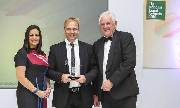Craig Schafer, head of commercial property, collects his award from host, broadcaster Leanne Manas (left), and awards judge Gary Berndt, Barloworld