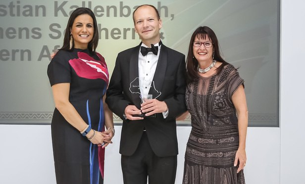 Christian Kallenbach collects his award from vawards host broadcaster Leanne Manas (left) and CCASA chief executive Alison Lee