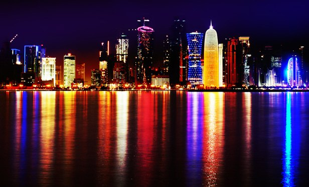 Doha_Qatar_skyline_at_night_Sept_2012-Article-201702070518