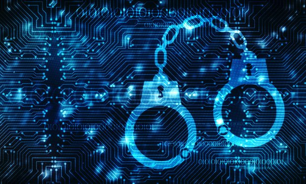 cybercrime and handcuffs