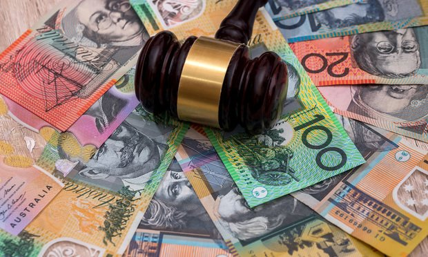 Judge's gavel on australian dollars, justice concept