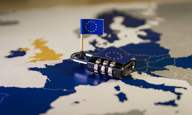 EU flags over map of Europe with combination lock