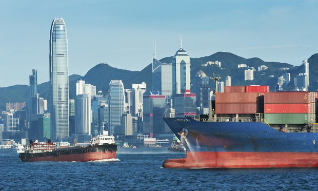 container ship in Victoria Harbor in Hong Kong