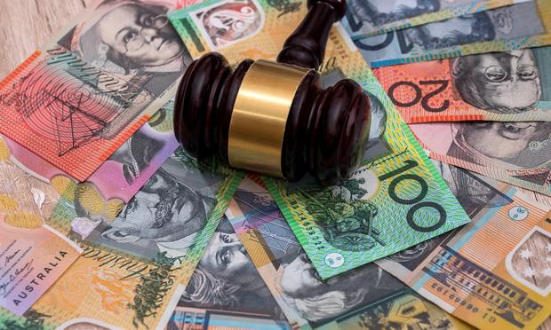 Judge's gavel on australian dollars