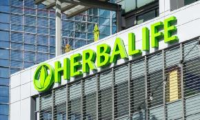 Herbalife Executives Charged in 'Brazen' Bribery Scheme in China