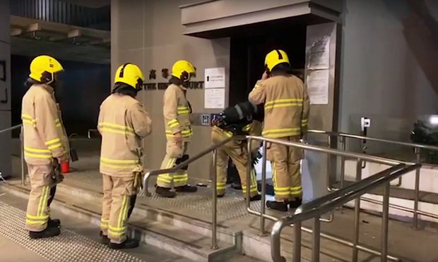 firefighters outside a courthouse in Hong Kong