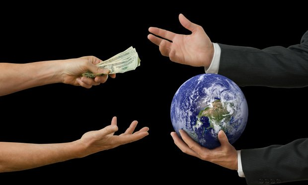 money exchanging hands with globe