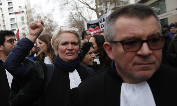 Lawyers attend a demonstration against proposed pension reforms on Jan. 11, 2020 in Paris.