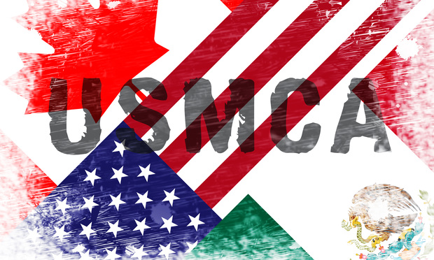flags of the U.S., Mexico and Canada with USMCA stamped across them.