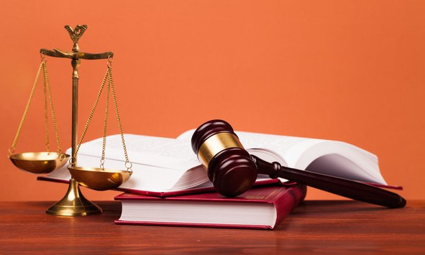 gold scales law books and a gavel