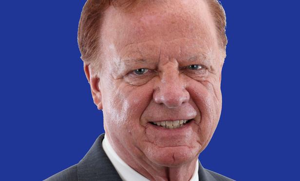 C. Raymond Radigan