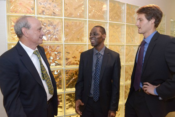 Kareem Bellamy, center, with his attorney Thomas Hoffman, left, and Jonathan Hiles, a Harvard Law School student who assisted Hoffman in the case.