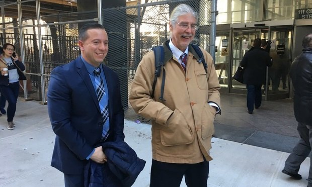 Johnny Hincapie, left, with Ronald Kuby, who was his attorney during Hincapie's bid to get his conviction overturned, speak with reporters on Jan. 25, 2017, outside the Manhattan Civil Court building following the announcement that Manhattan District Attorney Cyrus Vance Jr. will not retry Hincapie for a 1990 murder that he says he didn't commit. Photo by Andrew Denney