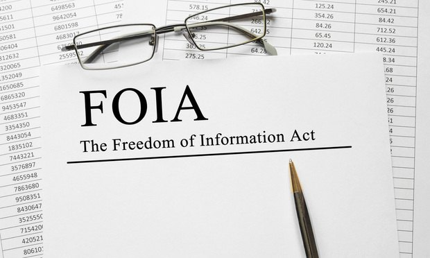 Paper with The Freedom of Information Act FOIA on a table