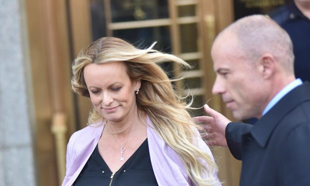 Stormy Daniels and lawyer Michael Avenatti leave the Daniel P. Moynihan Courthouse in Manhattan after a hearing in front of Judge Kimba Wood regarding a search warrant that was executed at the home, hotel and office of Trump's lawyer Michael Cohen. ..(Photo by David Handschuh/NYLJ)..