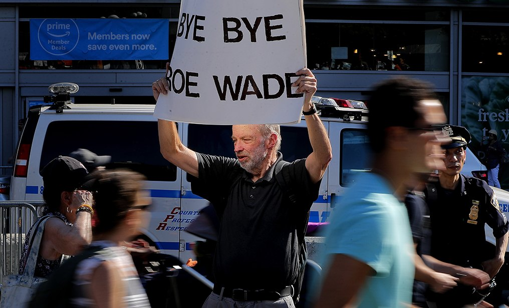 A counter protester holds a sign while standing on the sidewalk at Union Square during a pro-choice rally, on July 10. Many Democrats and abortion-rights supporters believe a new conservative justice could tilt the court in favor of overturning Roe v. Wade.