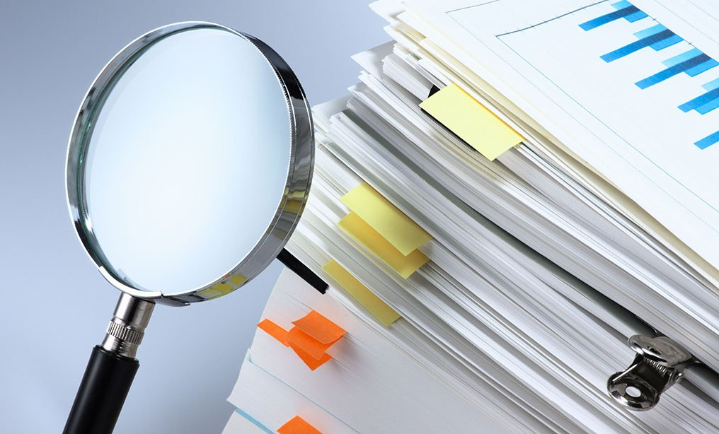 magnifying glass documents discovery