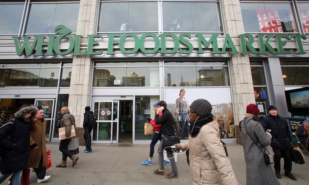 Pedestrians walk past a Whole Foods supermarket in New York. Credit: Northfoto/Shutterstock.com